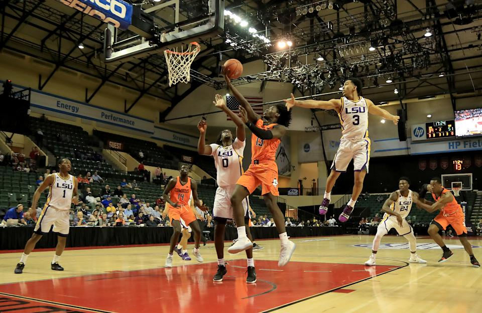 ORLANDO, FLORIDA - NOVEMBER 25: Isaac Likekele #13 of the Oklahoma State Cowboys drives past Tremont Waters #3 of the LSU Tigers during the game at HP Field House on November 25, 2018 in Orlando, Florida. (Photo by Sam Greenwood/Getty Images)