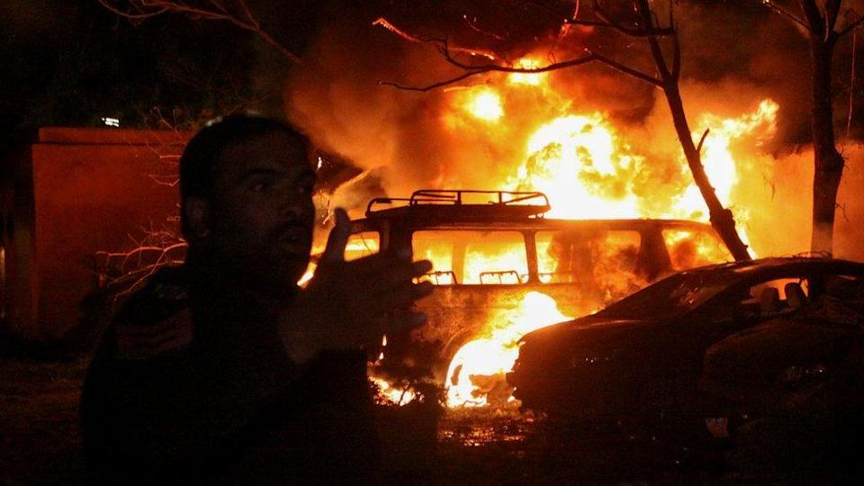 A police officer reacts after an explosion at a luxury hotel in Quetta, Pakistan