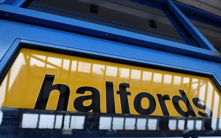 FILE PHOTO: A sign is seen on the front door of a branch of Halfords in west London, Britain July 15, 2015. REUTERS/Toby Melville/File Photo