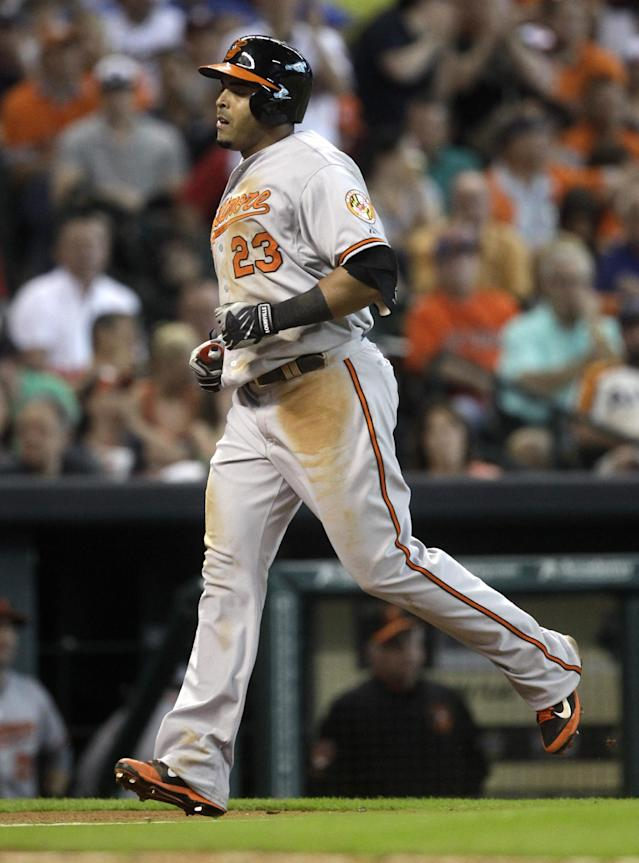 Baltimore Orioles' Nelson Cruz heads for home plate after hitting a solo home run during the eighth inning of a baseball game against the Houston Astros, Saturday, May 31, 2014, in Houston. The Orioles defeated the Astros 4-1. (AP Photo/Patric Schneider)