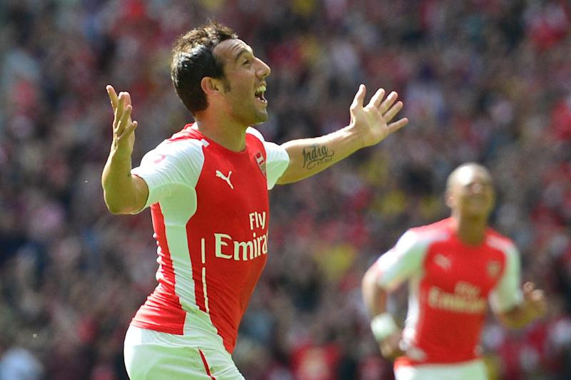 Arsenal's Santi Cazorla (L) celebrates scoring the opening goal during their FA Community Shield match against Manchester City, at Wembley Stadium in north London, on August 10, 2014 (AFP Photo/Carl Court)