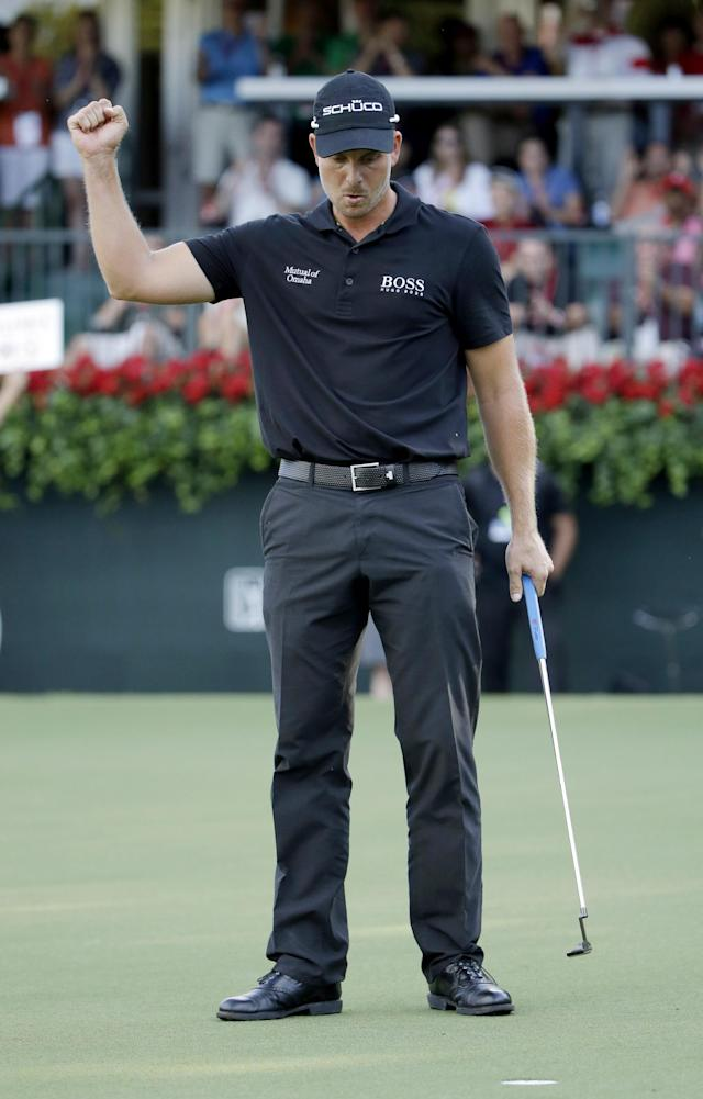 Henrik Stenson, of Sweden, celebrates after sinking a putt on the 18th hole to win the Tour Championship golf tournament and FedEx Cup at East Lake Golf Club, in Atlanta, Sunday, Sept. 22, 2013. (AP Photo/David Goldman)