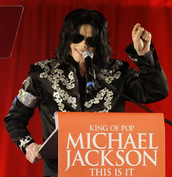 """FILE - In this March 5, 2009 file photo, Michael Jackson announces several concerts at the London O2 Arena in July, at a press conference at the London O2 Arena. Jurors hearing a case filed by Katherine Jackson over her son Michael's death have received a behind-the-scenes look at the superstar's troubles off-camera as he prepared for his ill-fated comeback shows. The panel was reminded on Thursday, Aug. 8, 2013, of statements describing the """"Thriller"""" singer as deteriorating and slow to pick up material for the shows that would heavily feature the hits that made him famous, but defense attorneys for concert promoter AEG Live LLC say the """"This Is It"""" footage is an accurate portrayal of his preparations and doesn't show Jackson in decline. (AP Photo/Joel Ryan, file)"""