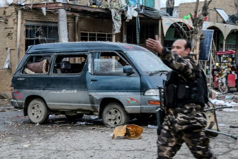 Afghan security personnel arrive after two blasts ripped through the city of Bamiyan on November 24, 2020
