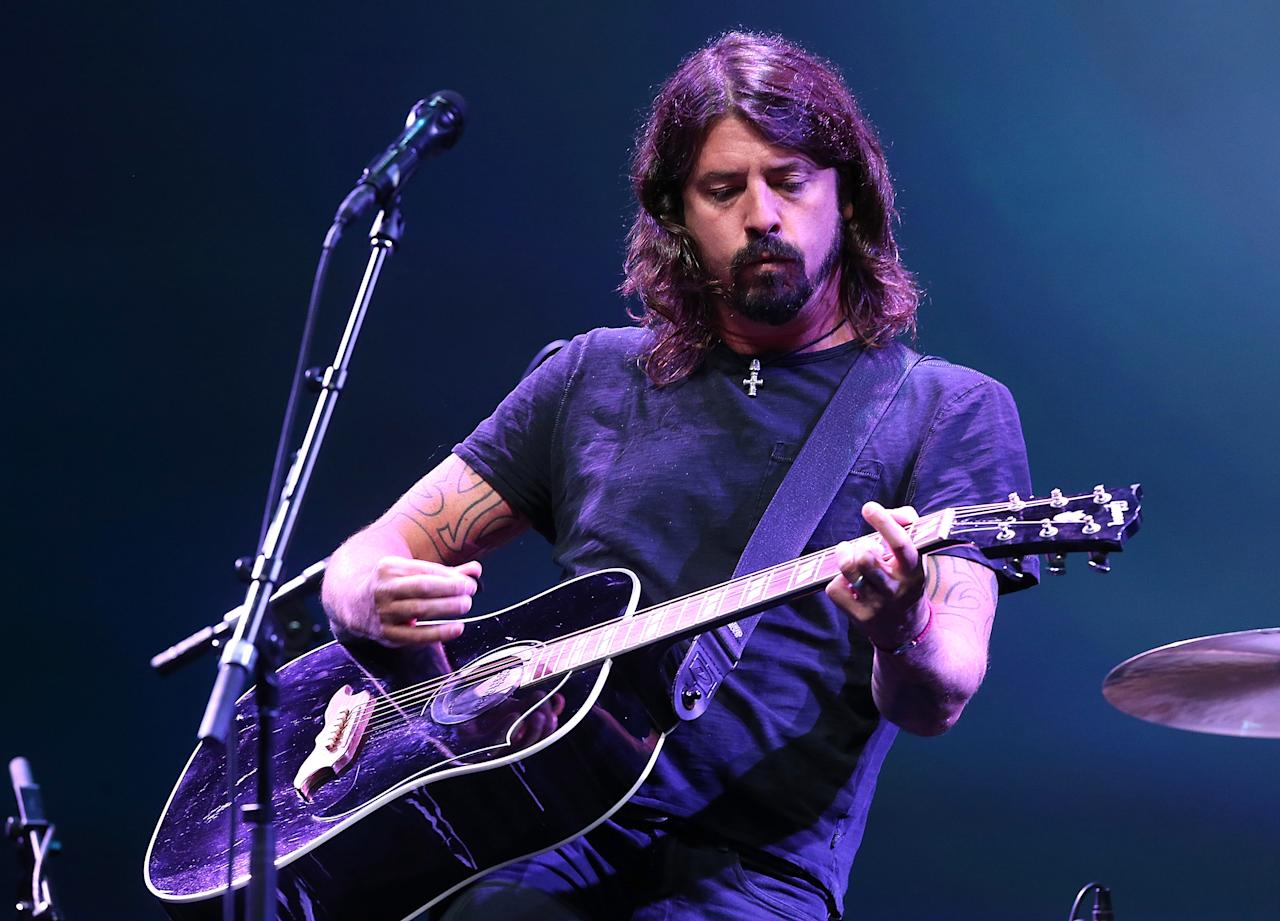 SAN FRANCISCO, CA - SEPTEMBER 12:  Dave Grohl of the Foo Fighters performs during an Apple special event at the Yerba Buena Center for the Arts on September 12, 2012 in San Francisco, California. Apple announced the iPhone 5, the latest version of the popular smart phone.  (Photo by Justin Sullivan/Getty Images)