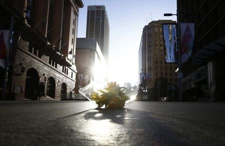 A bouquet is pictured inside a secured area at the scene of a hostage taking at Martin Place after it ended in Sydney early December 16, 2014. REUTERS/Jason Reed