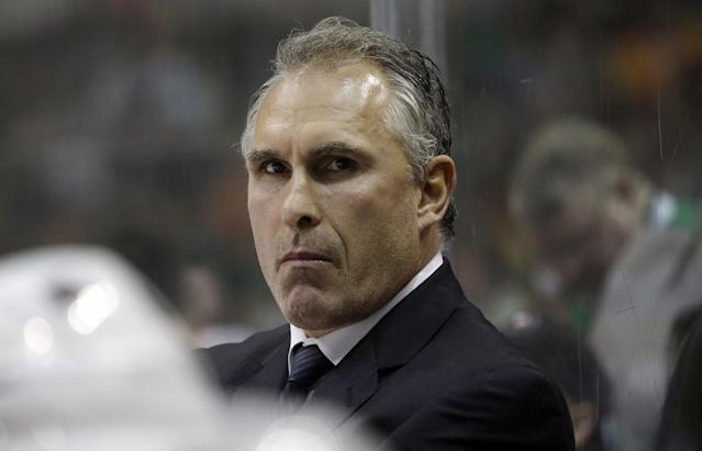 "FILE - In this Oct. 18, 2014, file photo, Philadelphia Flyers head coach Craig Berube looks on from the bench during the first period of an NHL hockey game against the Dallas Stars in Dallas. Berube played in the NHL from 1986-2004 and accumulated 3,149 penalty minutes, seventh of all time. He hasn't been a pushover on the bench, either. ""When he gets barking, you don't want to be making eye contact with him too much,"" Flyers forward Wayne Simmonds said. (AP Photo/LM Otero, File)"
