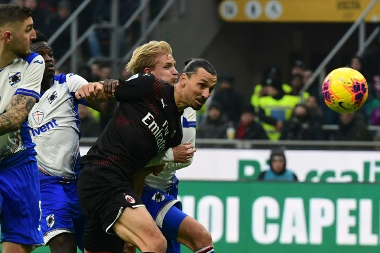 Zlatan Ibrahimovic goes for a header in his first match back for AC Milan against Sampdoria