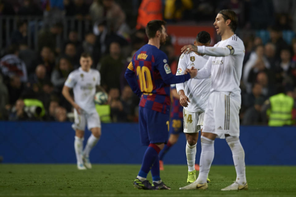 Lionel Messi of Barcelona and Sergio Ramos of Real Madrid  greet each other during the Liga match between FC Barcelona and Real Madrid CF at Camp Nou on October 26, 2019 in Barcelona, Spain. (Photo by Jose Breton/Pics Action/NurPhoto via Getty Images)