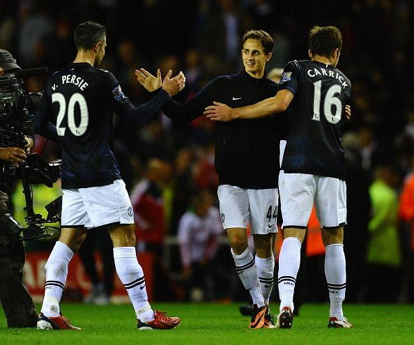 Adnan Januzaj is congratulated on his goals by Robin Van Persie and Michael Carrick after victory in the Barclays Premier League match between Sunderland and Manchester United at Stadium of Light on October 5, 2013 in Sunderland, England. (Getty Images)