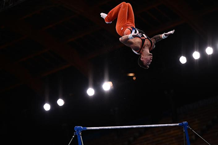 <p>Netherlands' Bart Deurloo competes in the artistic gymnastics men's horizontal bar final of the Tokyo 2020 Olympic Games at Ariake Gymnastics Centre in Tokyo on August 3, 2021. (Photo by Jeff PACHOUD / AFP) (Photo by JEFF PACHOUD/AFP via Getty Images)</p>