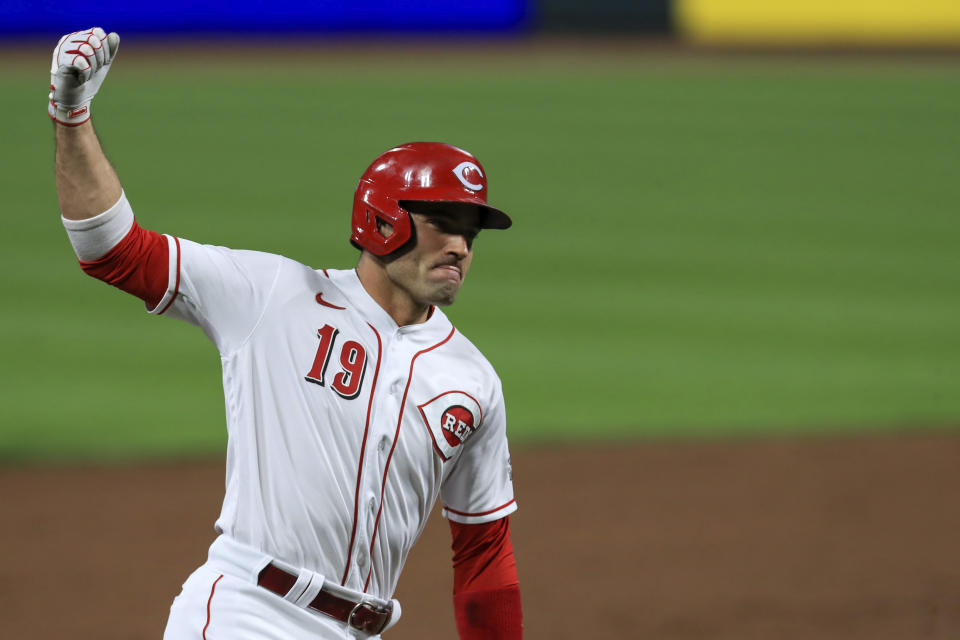 "FILE - Cincinnati Reds' Joey Votto reacts as he runs the bases after hitting a solo home run in the third inning during a baseball game against the Pittsburgh Pirates in Cincinnati, in this Monday, Sept. 14, 2020, file photo. Votto is determined to be a power-hitter again. ""I want to get back to being dangerous,"" the 37-year-old first baseman said from Cincinnati Reds spring training complex in Goodyear, Arizona.(AP Photo/Aaron Doster, File)"