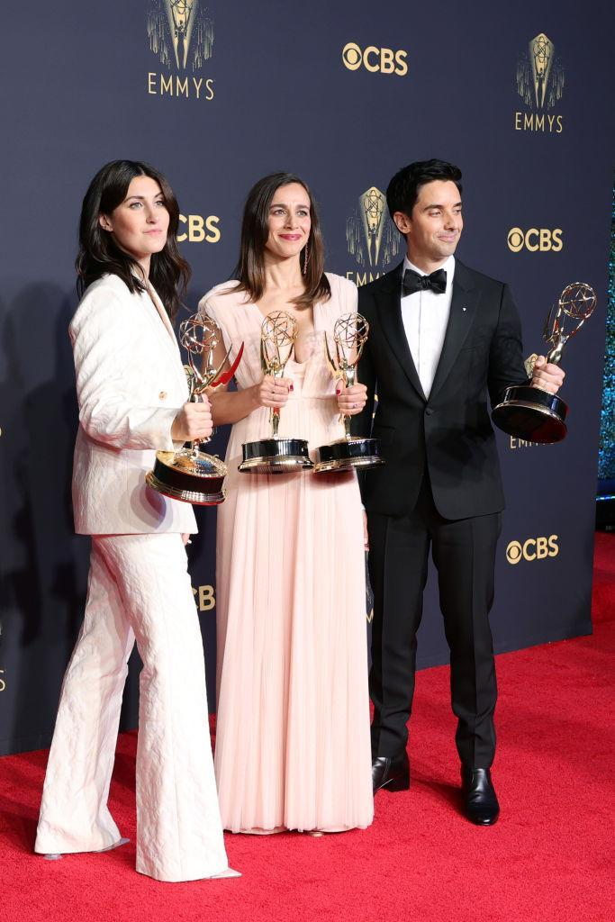 LOS ANGELES, CALIFORNIA - SEPTEMBER 19: (L-R) Jen Statsky, Lucia Aniello, and Paul W. Downs, winners of Outstanding Writing For A Comedy Series and Outstanding Directing For A Comedy Series for 'Hacks,' pose in the press room during the 73rd Primetime Emmy Awards at L.A. LIVE on September 19, 2021 in Los Angeles, California. (Photo by Rich Fury/Getty Images)