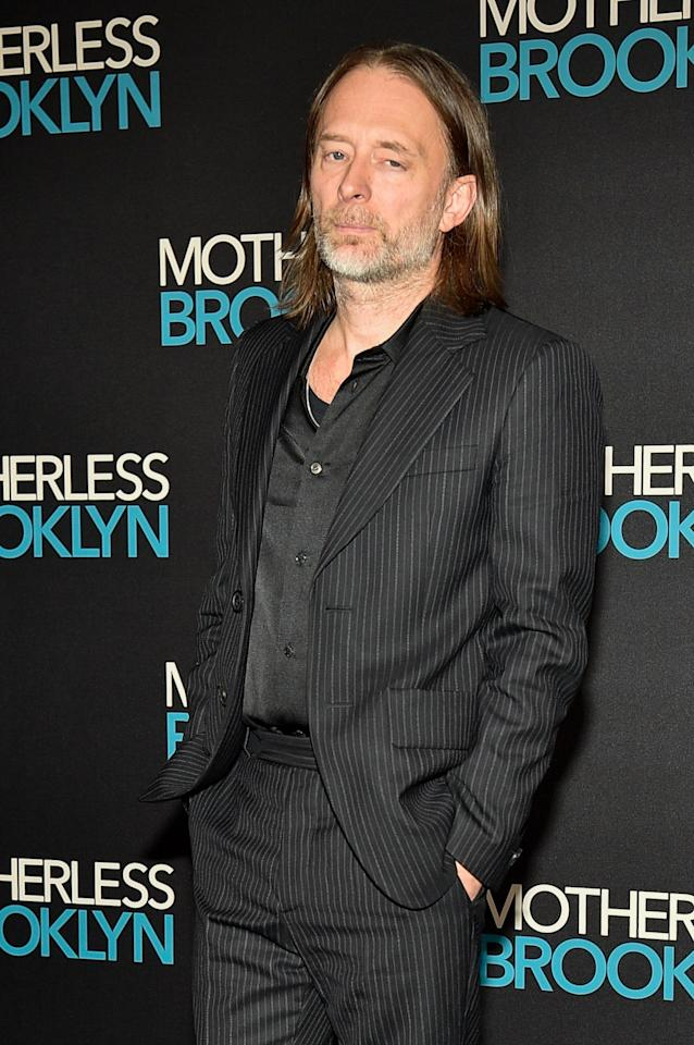 """Thom Yorke has never looked more stylish—and that's <a href=""""https://www.gq.com/story/thom-yorke-bleached-hair?mbid=synd_yahoo_rss"""">saying a lot.</a> A lesson: Grow your hair out, and wear your pinstripe suit."""