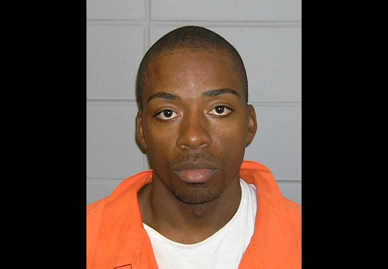 """FILE - This undated photo provided by the FBI shows Jose Banks, one of two inmates who escaped from the Metropolitan Correctional Center in downtown Chicago Tuesday, Dec. 18, 2012.  FBI spokeswoman Joan Hyde said Joseph """"Jose"""" Banks, 37, was captured without incident Thursday Dec. 20, 2012. Agents and officers from the Chicago FBI's Violent Crimes Task Force, along with officers from the Chicago Police Department, arrested Banks about 11:30 p.m. Thursday in Chicago, Hyde said in a news release. (AP Photo/FBI, File)"""