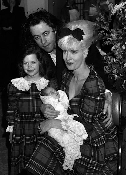 "FILE - In this March 16, 1989 file photo rock star Bob Geldof, his wife, TV presenter Paula Yates, right, and their five-year-old daughter Fifi Trixiebelle, left, show off the new addition to their family, an as yet unnamed baby girl, later named Peaches, at St Mary's Hospital in Paddington, London. Peaches Geldof, the model and television presenter who was concert organizer Bob Geldof's daughter, has died at age 25. Bob Geldof said in a statement Monday, April 7, 2014: ""Peaches has died. We are beyond pain."" (AP Photo/PA, Martin Keene, File) UNITED KINGDOM OUT, NO SALES, NO ARCHIVE"