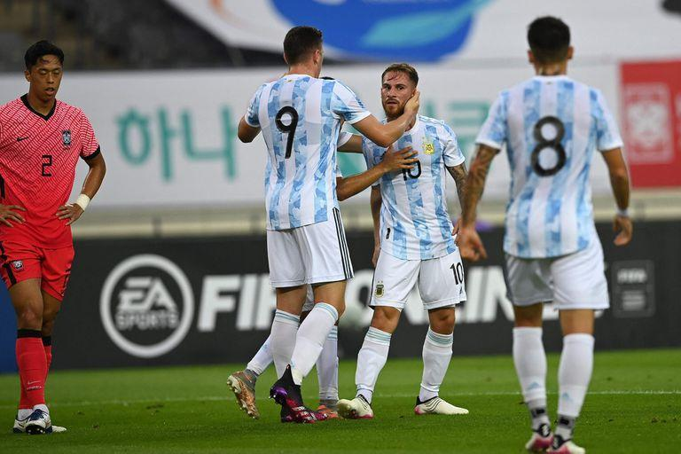 Argentina's Alexis Mac Allister (2nd R) celebrates his goal with his teammates against South Korea during their friendly football match in Yongin on July 13, 2021, ahead of the 2020 Tokyo Olympic Games. (Photo by Jung Yeon-je / AFP)
