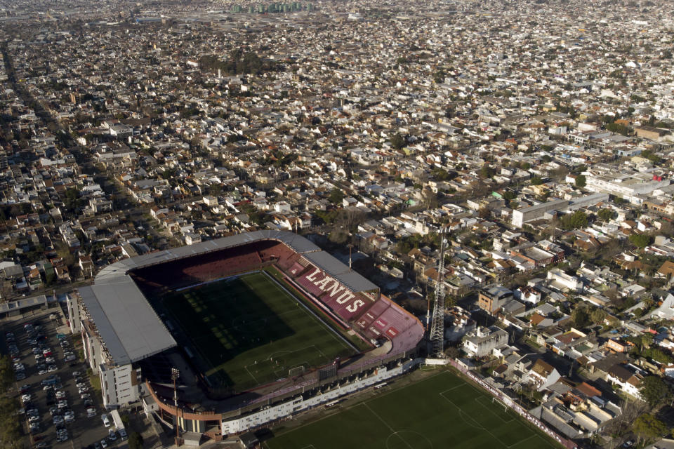 The home stadium for Lanus soccer team, Lanus City Stadium, stands devoid of fans due to COVID-19 pandemic restrictions during a match between Lanus and Gimnasia de La Plata in Lanus, Argentina, Thursday, Aug. 26, 2021. It's been 20 months since the government banned spectators at stadiums. (AP Photo/Mario De Fina)
