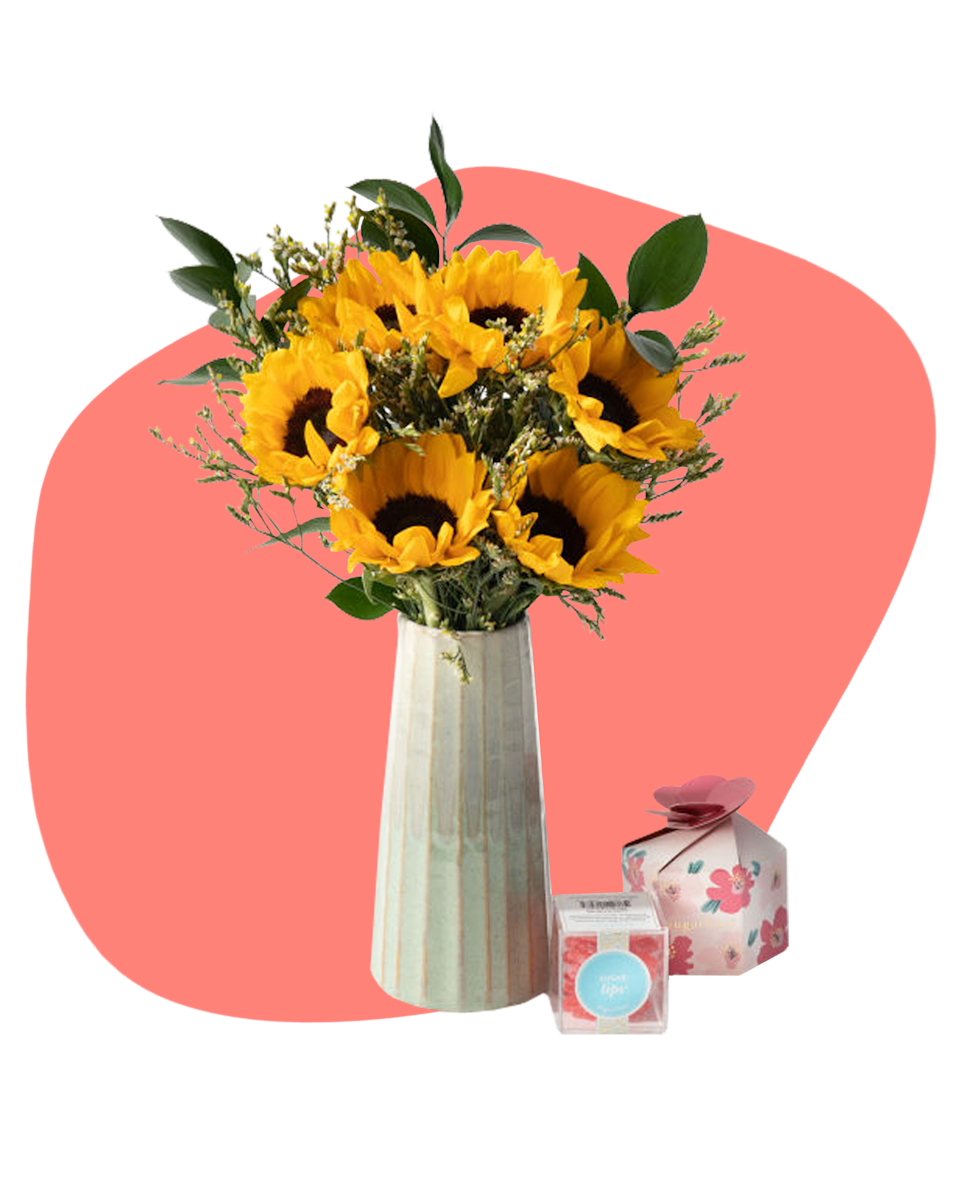 """Flowers and candy– when in doubt, keep it classic. $75, Urbanstems. <a href=""""https://urbanstems.com/products/flowers/the-helaine/FLRL-K-00596.html"""" rel=""""nofollow noopener"""" target=""""_blank"""" data-ylk=""""slk:Get it now!"""" class=""""link rapid-noclick-resp"""">Get it now!</a>"""