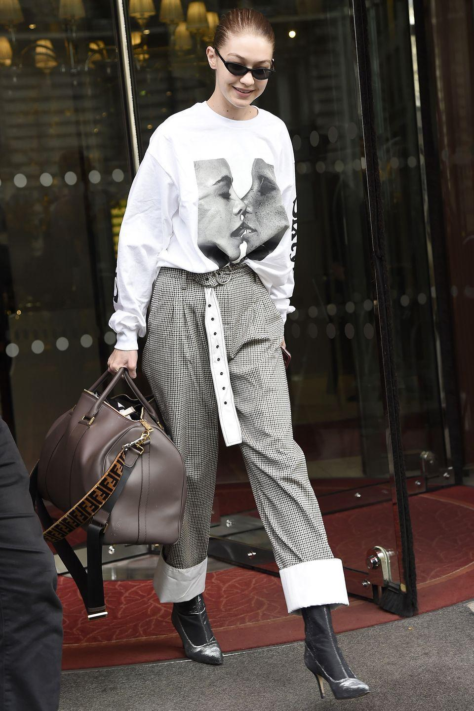 """<p>In a Chaos SixtyNine graphic tee (featuring Cara Delevingne and Adwoa Aboah's <a href=""""https://hypebae.com/2017/11/cara-delevingne-adwoa-aboah-kendall-jenner-chaos-sixtynine-cover"""" rel=""""nofollow noopener"""" target=""""_blank"""" data-ylk=""""slk:kissing cover shot"""" class=""""link rapid-noclick-resp"""">kissing cover shot</a>), cuffed houndstooth trousers, sock boots, Fendi duffle bag, and cateye sunglasses while out in Paris.</p>"""