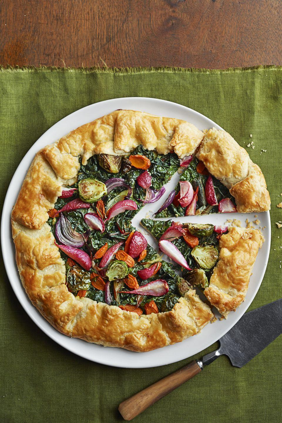 "<p>It's almost like having pie for dinner ... but, instead of caramelized fruits, there are sprouts, Swiss chard, onions and carrots piled atop that buttery crust. </p><p><a href=""https://www.goodhousekeeping.com/food-recipes/a16046/winter-veggie-tarts-recipe-ghk1214/"" rel=""nofollow noopener"" target=""_blank"" data-ylk=""slk:Get the recipe for Winter Veggie Tarts »"" class=""link rapid-noclick-resp""><em>Get the recipe for Winter Veggie Tarts »</em></a> </p>"