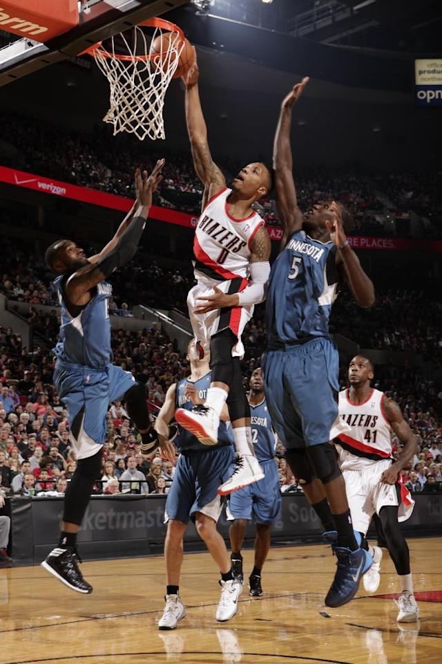 PORTLAND, OR - FEBRUARY 23: Damian Lillard #0 of the Portland Trail Blazers goes up for a dunk during a game against the Minnesota Timberwolves on February 23, 2014 at the Moda Center Arena in Portland, Oregon. (Photo by Sam Forencich/NBAE via Getty Images)