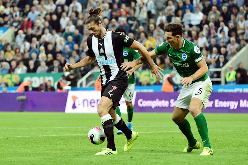 NEWCASTLE UPON TYNE, ENGLAND - SEPTEMBER 21: Andy Carroll of Newcastle United holds off Lewis Dunk of Brighton and Hove Albion during the Premier League match between Newcastle United and Brighton & Hove Albion at St. James Park on September 21, 2019 in Newcastle upon Tyne, United Kingdom. (Photo by Mark Runnacles/Getty Images)