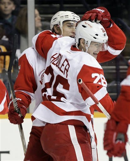 Detroit Red Wings center Valtteri Filppula, of Finland, left, celebrates with Jiri Hudler (26), of Czech Republic, after Filppula scored against the Nashville Predators in the first period of an NHL hockey game on Monday, Dec. 26, 2011, in Nashville, Tenn. (AP Photo/Mark Humphrey)