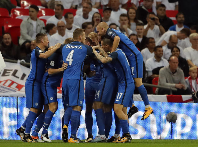<p>CORRECTS PHOTOGRAPHERS NAME TO FRANK AUGSTEIN Slovakia's players celebrate the opening goal during the World Cup Group F qualifying soccer match between England and Slovakia at the Wembley stadium in London, Great Britain, Monday, Sept. 4, 2017. (AP Photo/Frank Augstein) </p>