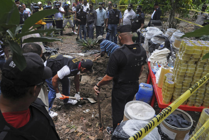 In this Sept. 1, 2013, Dominican anti-drug police officers unearth items that were allegedly used in a lab to process drugs, in San Cristobal, about 25 miles (40 kilometers) west of Santo Domingo, Dominican Republic. The central Caribbean as a whole seems to be coming back into favor with transnational drug cartels, with authorities reporting sharp increases in cocaine seizures and scrambling resources to contain the apparent surge. (AP Photo/Manuel Diaz)