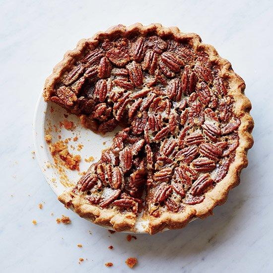 """<p>A Southern holiday treat that should have a place at every table, this easy pecan pie tastes of dark caramel, toasted nuts and a little bit of bourbon. This recipe uses a range of less-refined sweeteners like honey, and the press-in crust means you won't even need a rolling pin.</p> <p><strong>See more: <a href=""""https://www.foodandwine.com/slideshows/pecan-pie"""" target=""""_blank"""">Pecan Pie Recipes</a></strong></p> <p> <a href=""""https://www.foodandwine.com/recipes/bourbon-pecan-pie"""">Get the recipe</a></p>"""