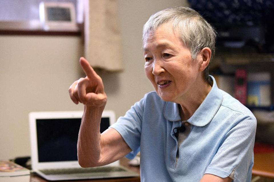 When 82-year-old Masako Wakamiya first began working she still used an abacus for maths -- today she is one of the world's oldest iPhone app developers, a trailblazer in making smartphones accessible for the elderly (AFP Photo/Kazuhiro NOGI)