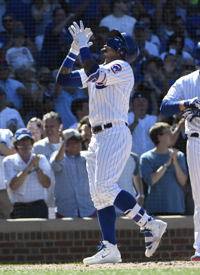 Chicago Cubs' Javier Baez (9) reacts as he crosses home plate after hitting a home run against the Cincinnati Reds during the seventh inning of a baseball game Saturday, July 7, 2018, in Chicago. (AP Photo/David Banks)
