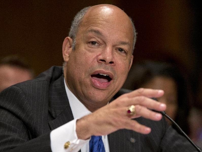 FILE - In this Nov. 13, 2013 file photo, Homeland Security Secretary nominee Jeh Johnson testifies on Capitol Hill in Washington before the Senate Homeland Security and Governmental Affairs Committee hearing on his nomination. Democrats begin a drive this week to muscle a half dozen of President Barrack Obama's Republican-opposed nominees through the Senate after clamping shackles on traditional minority party rights in last month's power play against the GOP. Republicans, however, still have some tools for grinding the Senate's work to an excruciatingly slow crawl. (AP Photo/Carolyn Kaster, File)