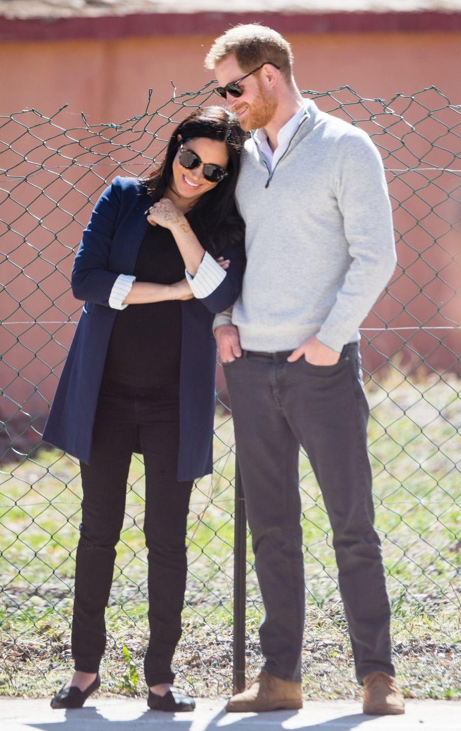 "<p>Meghan playfully leans on her husband while they visit a local secondary school in Asni, Morocco <a href=""https://www.townandcountrymag.com/society/tradition/g26364847/prince-harry-and-meghan-markle-morocco-2019-visit-photos/"" rel=""nofollow noopener"" target=""_blank"" data-ylk=""slk:during their official royal visit"" class=""link rapid-noclick-resp"">during their official royal visit</a>. </p>"