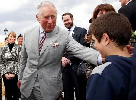 Britain's Prince Charles meet residents as he visit to the town of Amatrice, which was levelled after an earthquake last year, in central Italy April 2, 2017. REUTERS/Alessandro Bianchi