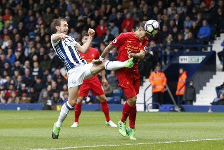 Britain Soccer Football - West Bromwich Albion v Liverpool - Premier League - The Hawthorns - 16/4/17 Liverpool's Roberto Firmino scores their first goal  Reuters / Andrew Yates Livepic
