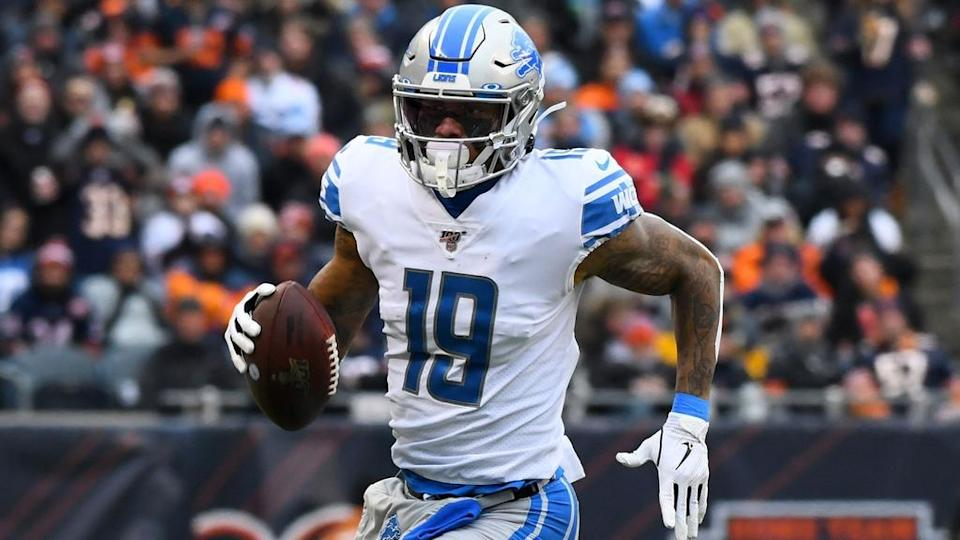 Kenny Golladay running with ball Lions white jersey