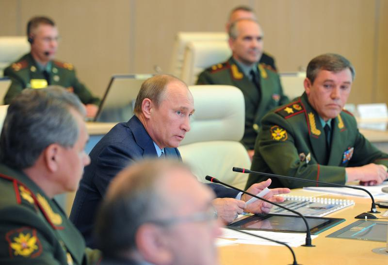 "Russian President Vladimir Putin, second left, has a meeting in the Russian Armed Forces main operational center in Moscow, Russia, Thursday, June 6, 2013. At right is Chief of the armed forces' General Staff Gen. Valery Gerasimov. and at left is Defense Minister Sergei Shoigu. President Vladimir Putin says Russia will permanently keep a navy squadron in the Mediterranean Sea to protect its interests. Speaking at Thursday's meeting with the military brass, Putin said the move shouldn't be interpreted as saber-rattling. He said the Mediterranean is a ""strategically important region, where we have interests connected with ensuring Russia's national security."" (AP Photo/RIA-Novosti, Mikhail Klimentyev, Presidential Press Service)"
