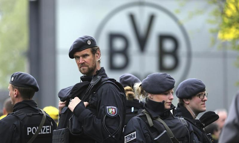 Police guard the entrance of the Dortmund stadium.