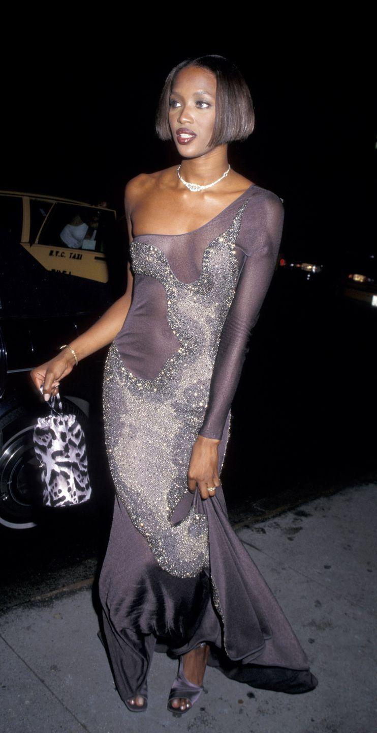 <p>The '90s were a time of OTT outfits and accessories, so loud, animal printed purses were the next logical step in the evolution of It Bags. Here, Naomi Campbell carried a leopard-print design while out in New York City. </p>