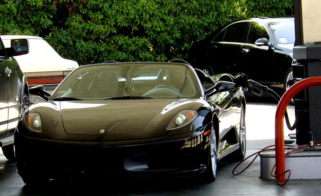 "Seal's shiny black Ferrari is one sweet ride. London Entertainment/<a href=""http://www.splashnewsonline.com"" target=""new"">Splash News</a>"