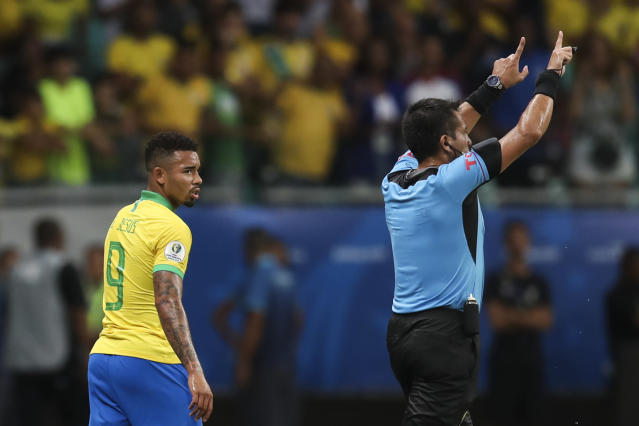 Referee Julio Bascunan, right, annuls the goal by Brazil's Gabriel Jesus, left, during a Copa America Group A soccer match at the Arena Fonte Nova in Salvador, Brazil, Tuesday, June 18, 2019. (AP Photo/Natacha Pisarenko)