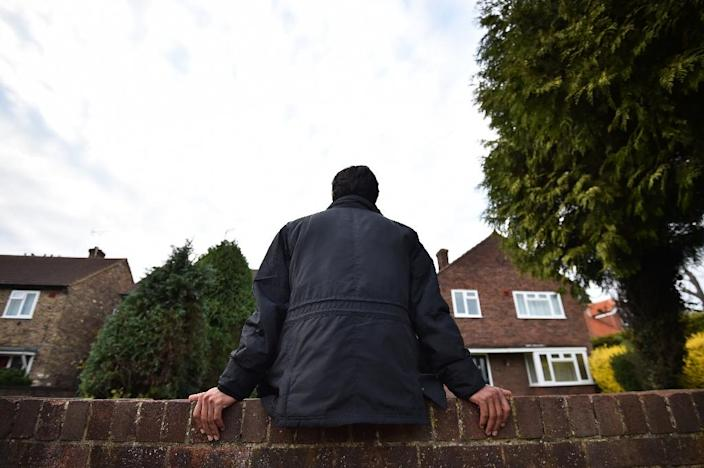 An Iranian asylum seeker sits on a wall outside his temporary accommodation in Longford, west London (AFP Photo/Ben Stansall)