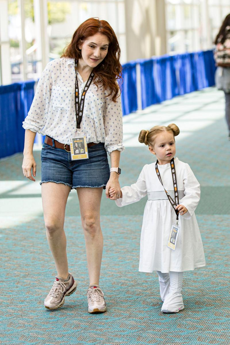 "A young girl dressed as Princess Leia from ""Star Wars."""