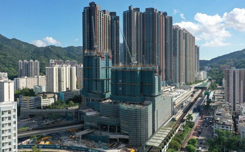 The Pavilia Farm III project, standing atop the MTR subway station in Tai Wai as of July 8, 2021, will be partially demolished because of a construction defect. The affected towers, blocks 1 and 8, are under construction above shopping centre. Photo: Sam Tsang