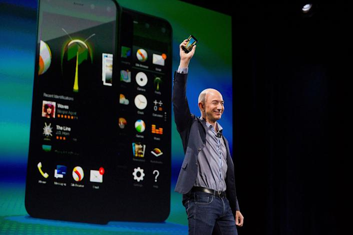 Jeff Bezos, CEO of Amazon, unveils the Fire Phone at an event in 2014. (Photo: Mike Kane/Bloomberg via Getty Images)