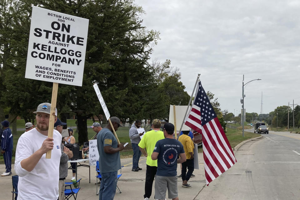 Workers from a Kellogg's cereal plant picket along the main rail lines leading into the facility on Wednesday, Oct. 6, 2021, in Omaha, Neb. Workers have gone on strike after a breakdown in contract talks with company management. (AP Photo/Grant Schulte).