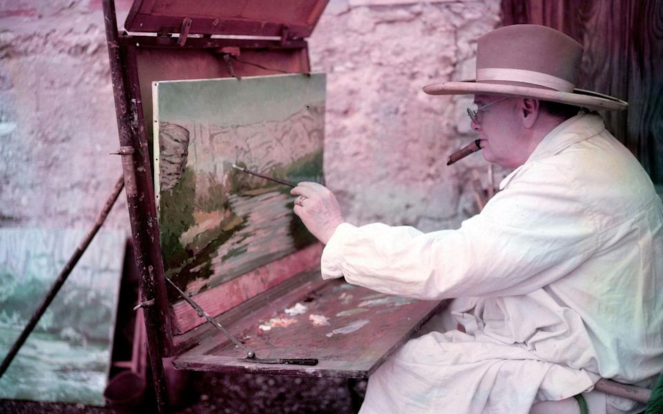 Winston Churchill painting a view of the Sorgue River while on holiday - Getty