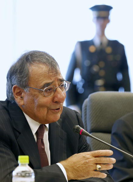 U.S. Secretary of Defense Leon Panetta talks while in meeting with Japan's Defense Minister Satoshi Morimoto at the Ministry of Defense in Tokyo, Monday, Sept. 17, 2012. (AP Photo/Larry Downing, Pool)